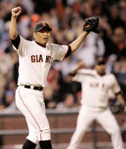 San Francisco Giants relief pitcher Keiichi Yabu celebrates after getting Kevin Kouzmanoff to ground out for an inning-ending triple play Friday in San Francisco. The Giants couldn't keep the ball from their first triple play turned since 1999, though, because it got lost in the bullpen.