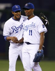 Kansas City's Jose Guillen, right, and Tony Pena Jr. celebrate after the Royals' 4-2 victory. The Royals won for the first time in nearly two weeks Saturday in Kansas City, Mo.
