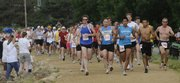 Runners participating in the 7th Annual Nash Dash start the 8K run on the Kansas River levee trail Saturday, May 31, 2008.