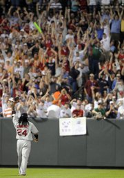 Manny Ramirez (24) acknowledges fans after hitting his 500th career home run. The Red Sox beat the Orioles, 6-3, on Saturday in Baltimore.