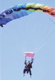 Carol Geary floats slowly back to the ground after sky diving out of a plane with her husband, Jim Geary, to celebrate their 49th wedding anniversary. Jim and Carol were each strapped to a trained sky diving professional when they made their free-fall jump April 5.
