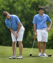 Blake Giroux, an incoming Kansas university golfer, makes a putt on the ninth hole. Giroux and teammate Bobby Knowles, right, who will be a junior on the KU team, shot a 70 on the first day of stroke play at the Kansas Golf Association Four-Ball Championship on Tuesday at Alvamar Golf Course.