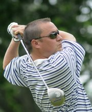 Former Kansas University golfer Chad Roesler tees off. He and teammate Conrad Roberts were eliminated in the first round of match play at the Kansas Golf Association Four-Ball Championship on Thursday at Alvamar.