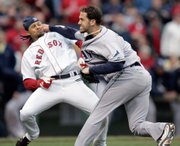 Tampa Bay pitcher James Shields, right, takes a swing at Boston's Coco Crisp after Crisp was hit by a pitch and charged the mound in the second inning. The Red Sox ended up defeating the Rays, 7-1, on Thursday in Boston.