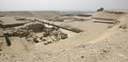 "Workers are seen at the site of a so-called ""missing"" pyramid, currently only a heap of rocks at the bottom of a dugout pit, on Thursday at Saqqara, Egypt. Egypt&squot;s chief archaeologist Zahi Hawass said his team had uncovered the missing pyramid of an ancient Pharaoh who ruled more than 4,000 years ago and a ceremonial procession road where high priests carried mummified remains of sacred bulls worshipped in Memphis, the capital of Egypt&squot;s Old Kingdom."