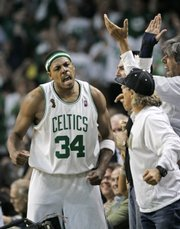 Boston's Paul Pierce (34) celebrates after hitting a three-point shot in the third quarter. The Celtics defeated the Lakers, 98-88, in Game 1 of the NBA finals on Thursday in Boston.