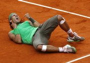 Defending champion Rafael Nadal reacts after defeating Serbia's Novak Djokovic during their French Open semifinal Friday in Paris, Nadal advanced to the championship match, where he'll face Roger Federer on Sunday.