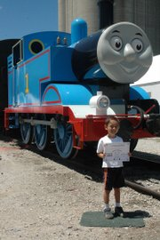 Harold Johnson, 6, celebrates his birthday by riding Thomas the Tank Engine Friday in Baldwin City. He was with his parents, Harold and Lydia Johnson, of North Kansas City, Mo. The event will run today, Sunday and the following weekend at the Midland Railway.
