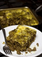 Bobotie, a South African dish, is a highly seasoned, meatloaf-like entree. Serve it with mashed potatoes for a filling and exotic meal.