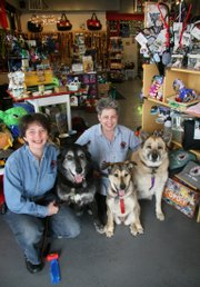 Pennye Jones-Napier, left, and Julie Paez, here with Bodhi, Zorra and Tumo, own the Big Bad Woof store in Takoma Park, Md. Pet owners spent $9.8 billion on supplies and medicines last year, an industry group says.