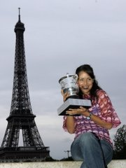 Serbia's Ana Ivanovic poses with her trophy in front the Eiffel Tower. Ivanovic won the French Open women's title by defeating Dinara Safina, 6-4, 6-3, on Saturday in Paris.