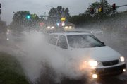 A van braves deep water at the intersection of Ousdahl and 23rd Streets on Sunday, June 8, 2008 during a thunderstorm and flash flood warning due to heavy rain.
