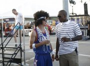 Justin Anderson, left, of Lawrence, chats with KU basketball senior Russell Robinson at Bill's Basketball Boogie. Robinson was among the Jayhawks on hand for the fundraiser Saturday at Kansas Speedway.