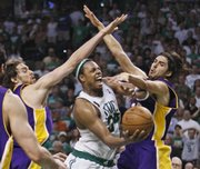 Boston's Paul Pierce, center, tries to scoop a shot between Pau Gasol, left, and Sasha Vujacic. The Celtics beat the Lakers, 108-102, Sunday in Boston.