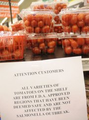 A sign at Checkers Foods, 2300 La., informs customers that tomatoes for sale are believed to be safe despite a recent salmonella outbreak. The farm bill on its way for approval in Washington doesn't have some of highest-profile proposals for food safety proposed by legislators.