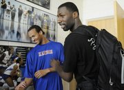 Former KU basketball player and current member of the New Orleans Hornets, Julian Wright, right, greets KU freshman Travis Releford, left, before Wright was introduced at the Bill Self Kansas Basketball Camp Tuesday, June 10, 2008.
