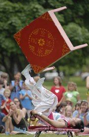 Wu Li Li, a member of the Fabulous Chinese Acrobats, spins a table with her feet during a local performance. The Chinese troupe performed two shows Wednesday in South Park.
