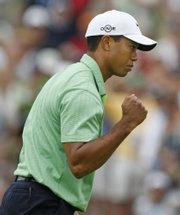 Tiger Woods reacts after making birdie on the fifth hole. Woods rallied on the front nine to pull within one stroke of the lead at the U.S. Open on Friday at Torrey Pines Golf Course in San Diego.