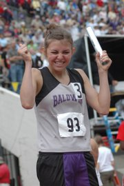 Baldwin's Heather Garcia shows her joy after crossing the finishing line at the state track meet in May.