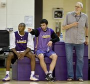 Los Angeles Lakers, from left, Kobe Bryant, Vladimir Radmanovic and coach Phil Jackson, look on during practice. The Lakers tuned up Saturday in El Segundo, Calif.