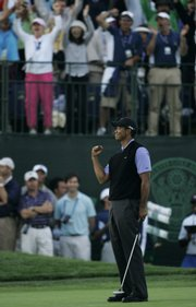Tiger Woods celebrates after an eagle on the 18th hole. The putt lifted Woods into a one-stroke lead after the third round of the U.S. Open on Saturday in San Diego.