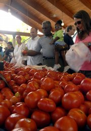Crowds of people line up to buy Arkansas-grown tomatoes at the Farmers Market Saturday in Little Rock, Ark. Because Arkansas tomatoes have not been linked to the recent salmonella outbreak, Arkansas tomato growers say they are seeing a boost in sales.