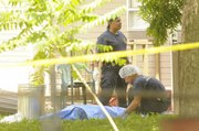 Richard Gwin took the photograph above after a double homicide last weekend in east Lawrence. News stories with fatalities pose a challenge for photojournalists - how to capture a scene yet remain sensitive to readers whom the story affects.