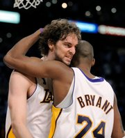 Los Angeles Lakers Kobe Bryant, right, and Pau Gasol embrace toward the end of Game 5 of the NBA finals. The Lakers won, 103-98, Sunday in Los Angeles.