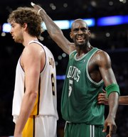 Boston's Kevin Garnett, right, reacts to his fifth foul as Lakers forward Pau Gasol walks by. The Lakers won, 103-98, Sunday in Los Angeles.