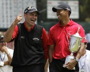 Rocco Mediate, left, jokes with Tiger Woods following Woods' U.S. Open victory on Monday in San Diego.