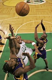 Boston's Paul Pierce, center, shoots over Los Angeles' Ronny Turiaf and Kobe Bryant. Pierce was named MVP of the NBA Finals after the Celtics defeated the Lakers, 131-92, in Game 6 on Tuesday in Boston.