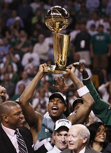 Boston's Paul Pierce hoists the Larry O'Brien Trophy. The Celtics crushed the Lakers in Game 6 of the NBA Finals on Tuesday in Boston, and Pierce was named MVP after the game. Pierce played at Kansas University from 1995 to 1998.