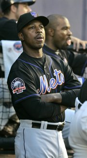 Willie Randolph looks on from the dugout during a recent Mets game in New York. Randolph was fired early Tuesday.