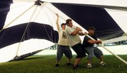 Workmen for Weiser Tent of Monette, Mo., from left, C.J. Flower, Dustin Bolze and Matt McCarter put up the main tent for Chautauqua on Wednesday June 18, 2008. The Chautauqua events will be held in South Park after the Band Concert on Wednesday night and each night thereafter through Sunday.