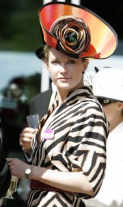 A racegoer wears an ornate hat on the third day of the Royal Ascot horse racing meeting, traditionally known as Ladies Day in Ascot, England, Thursday, June, 19, 2008.