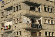 A Palestinian youth stands Thursday on a balcony of a building damaged in recent years of conflict with Israel in Rafah, southern Gaza Strip. Guns went quiet as a six-month truce between Israel and Gaza Strip militants took effect early Thursday, marred only by widespread skepticism about its ability to hold.