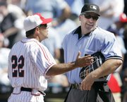 Kansas City Royals manager Trey Hillman, left, argues with home-plate umpire Bill Welke during the fifth inning. The Royals rallied for an 11-10 victory over the Giants on Sunday in Kansas City, Mo.