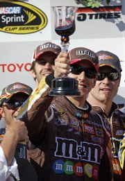 NASCAR driver Kyle Busch toasts his victory in the Sprint Cup Toyota/Save Mart 350. Busch held off David Gilliland and Jeff Gordon to claim the victory Sunday in Sonoma, Calif.