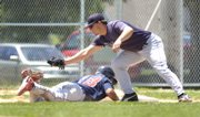 Caleb Gress, right, prepares to slap a tag on a Dodge City runner during a pickoff attempt at first.