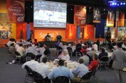 Kansas University men's basketball coach Bill Self holds court Tuesday at a luncheon at the College Basketball Experience in Kansas City, Mo.