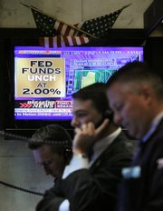 A television screen in a booth on the floor of the New York Stock Exchange shows the Fed rate decision on Wednesday. The central bank said after a two-day meeting it is keeping the benchmark federal funds rate at 2 percent. It is the first time in 10 months that the central bank hasn't cut rates.