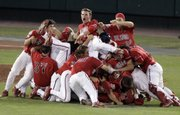 Fresno State players celebrate their College World Series victory over Georgia. Fresno State defeated Georgia, 6-1, on Wednesday in Omaha, Neb.