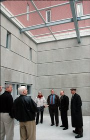 Lt. David K. Dillon, of the Douglas County Sheriff's Office, shown here second from right, died Saturday following an auto accident on North 1400 Road. This photograph was taken in 2006 as Dillon accompanied county commissioners on a tour of the minimum security and work-release area of the Douglas County Jail.