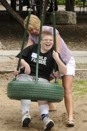 Nicholas Moix, 11, gets a push from his mother, Kelly Moix both of Conway, Ark.Nicholas and his mother were in town for a gathering of families from across the country who have had to cope with hemimegaencephaly, a disorder in which the brain develops abnormally. Saturday's event was at Raintree Montessori School.