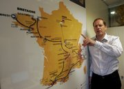 Tour de France director Christian Prudhomme points to this year's race map Thursday in Paris. For the second straight year, the race, set for July 5-27, will start without a defending champion.