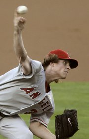 Los Angeles Angels pitcher Jered Weaver delivers against the Dodgers. Weaver allowed no hits in six innings Saturday in Los Angeles, but was the losing pitcher.