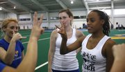 Kylei Brooks, 15, right, from the Kansas School for the Deaf, teaches KU junior Lauren Adams, left, of Olden, Texas, and others how to sign their names Saturday at KU's Spirit Camp at Anschutz Sports Pavilion. In the center is Vanessa Jackson, who helped interpret. The KSD cheerleading team participated in the camp.