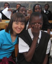Journal-World Copy editor Shanxi Upsdell poses for a photo with a Kenyan schoolchild during her trip with Teach My Kenyan Children.