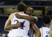 Sasha Kaun, left, and Darnell Jackson congratulate each other after KU's victory against Villanova in the Sweet 16 of the NCAA Tournament in Detroit. Both former KU post men were selected in the second round of the NBA Draft last week in New York. After a few trades, Kaun and Jackson will have the chance to be teammates again in Cleveland.