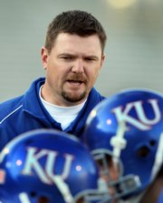Kansas defensive line coach Joe Bob Clements looks on during one of the Jayhawks' 2008 spring practices. Clements, who previously worked as the defensive ends coach at Kansas State and the defensive line coach at San Diego State, joined KU coach Mark Mangino's staff this spring as defensive line coach.
